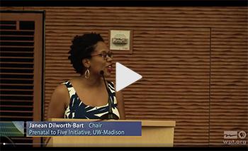 Video screenshot of Janean Dilworth-Bart at a podium